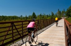 Bicyclists on a trail in Boulder Junction Wisconsin